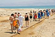 Tourist at the Ein Gedi Beach of the Dead Sea, Israel