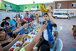 © Licensed to London News Pictures. 28/05/2017. Kırıkhan, TURKEY. Syrian orphans eat an iftar dinner at an orphanage on the Turkish-Syrian border in Kırıkhan, near Antakya, Turkey on the first day of Ramadan during Former Minister of State for Faith and Communities, Baroness Warsi's visit. Photo credit: Tolga Akmen/LNP
