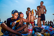 S&atilde;o Paulo, Brazil<br /> Members of the same family have a picnic at the Guarapiranga dam, in the south of S&atilde;o Paulo. The beach of a dam is a good option of entertainment for people who live far away from the sea and can't afford a road trip to the regular beach.