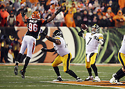 Pittsburgh Steelers tackle Marcus Gilbert (77) blocks Cincinnati Bengals defensive end Carlos Dunlap (96) as he leaps while trying to knock down a deep pass thrown by Pittsburgh Steelers quarterback Ben Roethlisberger (7) to Pittsburgh Steelers wide receiver Antonio Brown (84) that sets up the game winning field goal during the NFL AFC Wild Card playoff football game against the Cincinnati Bengals on Saturday, Jan. 9, 2016 in Cincinnati. The Steelers won the game 18-16. (©Paul Anthony Spinelli)