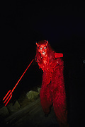 Costumed devil woman stilt walker Ibiza 1990's