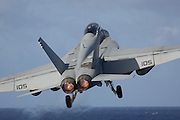 F/A-18 Super Hornet taking off from aircraft carrier.