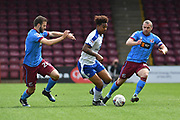 Scunthorpe United midfielder Jamie Ness (26) , Chesterfield FC midfielder Rai Simons (22) and Scunthorpe United midfielder Stephen Dawson (8)  during the EFL Sky Bet League 1 match between Scunthorpe United and Chesterfield at Glanford Park, Scunthorpe, England on 17 April 2017. Photo by Ian Lyall.