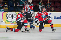 KELOWNA, CANADA - NOVEMBER 5: Rodney Southam #17 and Austin Glover #20 of Kelowna Rockets stretch on the ice during warm up against the Victoria Royals on November 5, 2014 at Prospera Place in Kelowna, British Columbia, Canada.  (Photo by Marissa Baecker/Shoot the Breeze)  *** Local Caption *** Rodney Southam; Austin Glover;