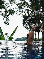 Thailand young woman relaxing in swimming pool