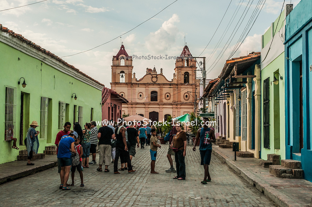 Cuba, Camaguey. Street art Plaza del Carmen Nuestra Senora de la Candelaria Church in the background