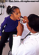 doctor, physician at work African American Physician and Black Child Patient