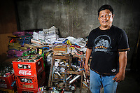 Bapak Alimuddin at his recycling business outside Jongaya leprosy settlment, Makassar, Sulawesi, Indonesia. Bapak Alimuddin, 47, is a Bugis, originally from Bone, Sulawesi.  He found out that he was infected with leprosy at the age of 12 and moved to Jongaya leprosy settlement in 1980.  He is married with four children - none of whom have leprosy.  He used to work as a parking attendant in Makassar but with recent increases in taxes, could no longer support his family and so set up his own recycling business using seed money from Permata.  The business has been running for just two week