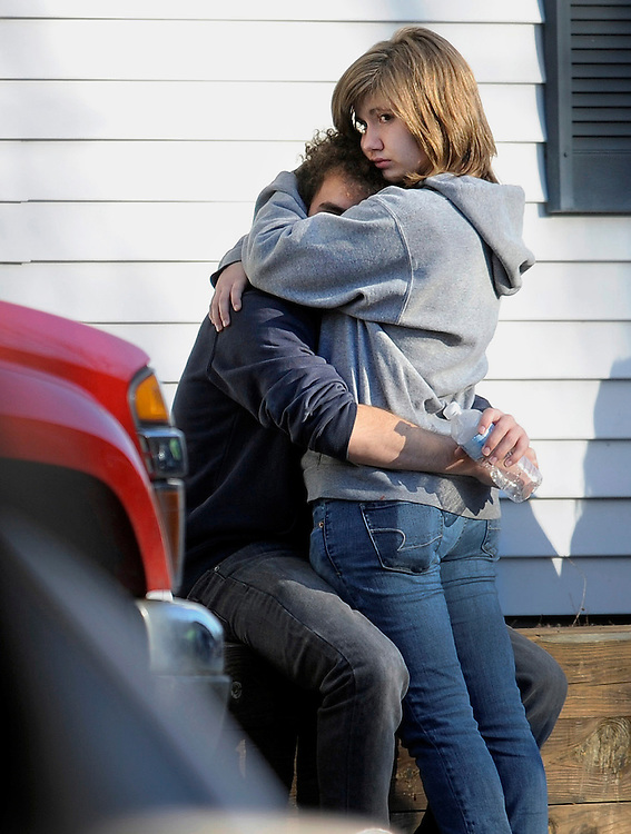 People embrace at a firehouse staging area for family around near the scene of a shooting at the Sandy Hook Elementary School in Newtown, Conn. where authorities say a gunman opened fire, leaving 26 people dead, including 20 children, Friday, Dec. 14, 2012. (AP Photo/Jessica Hill)