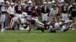 Texas A&M wide receiver Christian Kirk (3) is tackled by Auburn defensive back Jeremiah Dinson (20) and linebacker Jeff Holland (4) during the second quarter of an NCAA college football game on Saturday, Nov. 4, 2017, in College Station, Texas. (AP Photo/Sam Craft)