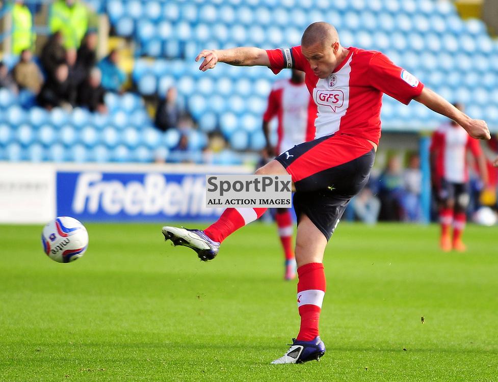 Gary Alexander (Crawley Town, red) shoots for goal..Carlisle v Crawley, Npower League One, 29th September 2012..(c)  Alex Todd | StockPix.eu