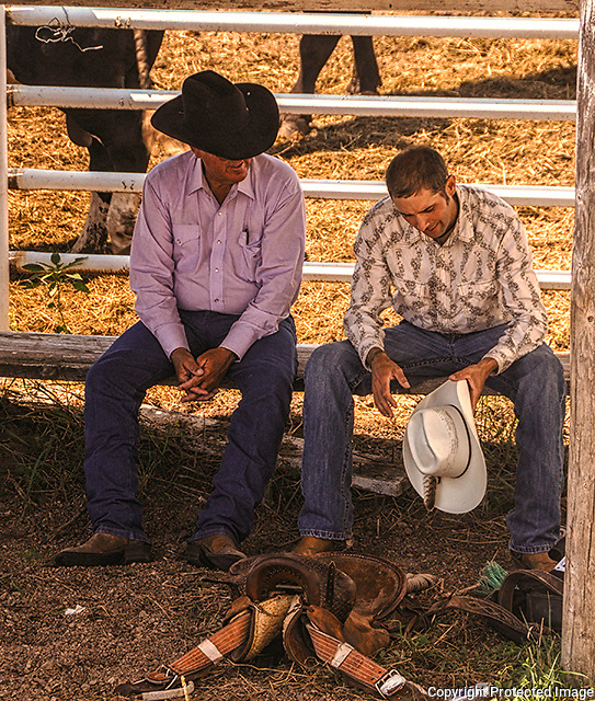 Rodeo Cowboys share stories following their event under sweltering temps in Burwell, Nebraska. Photo by accomplished Lincoln Nebraska Sports Photographer Barry A Mosley.