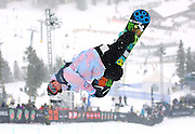 12/20/08 1:24:30 PM -- Breckenridge, CO, U.S.A. -- Snowboarder Louie Vito of Bellefontaine, Ohio spins while inverted in the superpipe at the inaugural Winter Dew Tour in Breckenridge, Co. on December 20, 2008. Vito finished fifth in the event with a score of 81. The four-day competition is the first of three stops on the tour that features freeskiing and snowboarding..(Photo by Marc Piscotty / © 2008)