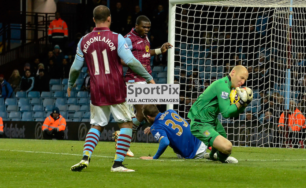 Brad Guzan gathers a cross under pressure from Chris Wood (c) Simon Kimber | SportPix.org.uk