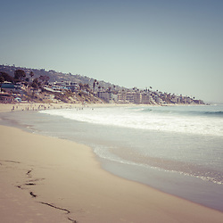 Laguna Beach retro picture of the beach and Pacific Ocean shoreline. Photo has vintage 1960's tone. Laguna Beach is a popular beach community in Orange County California. Image Copyright © Paul Velgos All Rights Reserved.