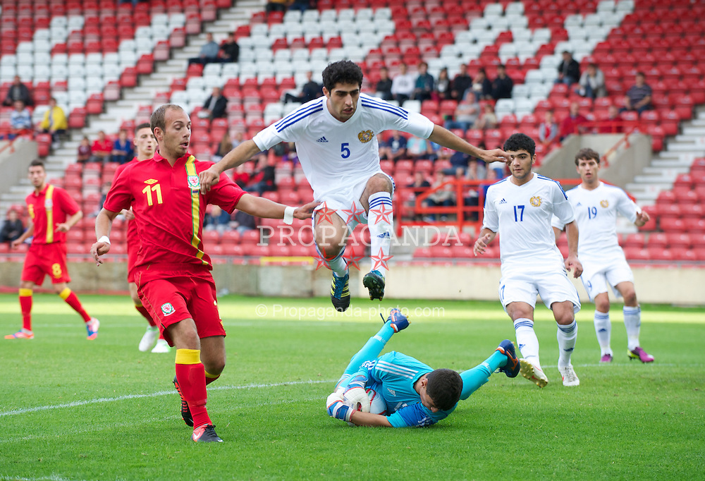 WREXHAM, WALES - Wednesday, August 15, 2012: Wales' Jake Howells in action against Armenia's Andranik Voskanyan and goalkeeper Gor Elyazyan during the UEFA Under-21 Championship Qualifying Round Group 3 match at the Racecourse Ground. (Pic by Dave Richards/Propaganda)