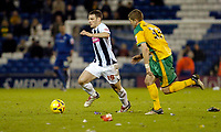 Photo: Leigh Quinnell.<br /> West Bromwich Albion v Norwich City. Coca Cola Championship. 11/11/2006. West Broms Jason Koumas gets past Norwichs' Carl Robinson on a rubbish strewn pitch.
