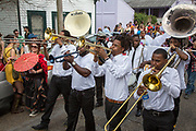 New Breed Brass Band performs in the Red Beans Parade on Lundi Gras 2017 in Faubourg Marigny
