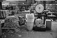 Circular processed jute being weighed at Tay Spinners mill in Dundee, Scotland. This factory was the last jute spinning mill in Europe when it closed for the final time in 1998. The city of Dundee had been famous throughout history for the three 'Js' - jute, jam and journalism.