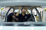 Chinese workers build a new BMW on an assembly line in a factory in Shenyang. The German luxury auto maker expects its vehicle sales in China to hit 22 thousand units in 2005, including imports. Last year (2004), BMW posted a 16 percent fall in vehicle sales in China to 15 thousand units, including imports. BMW makes its luxury sedans in China with local partner Brilliance China Automotive Holdings Limited.