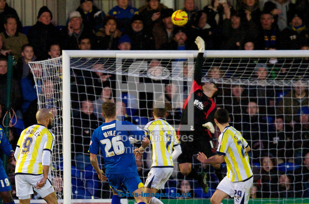 Picture by Alan Stanford/Focus Images Ltd +44 7915 056117<br /> 11/01/2014<br /> Goalkeeper Michael Poke of Torquay United makes a save late in the game during the Sky Bet League 2 match at the Cherry Red Records Stadium, Kingston.