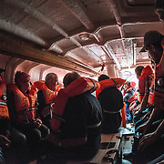 Passengers go through the initial lifeboat drill aboard the Polar Pioneer bound for Antarctica. The drill requires that all passengers put on their life vests and assemble inside the lifeboats.