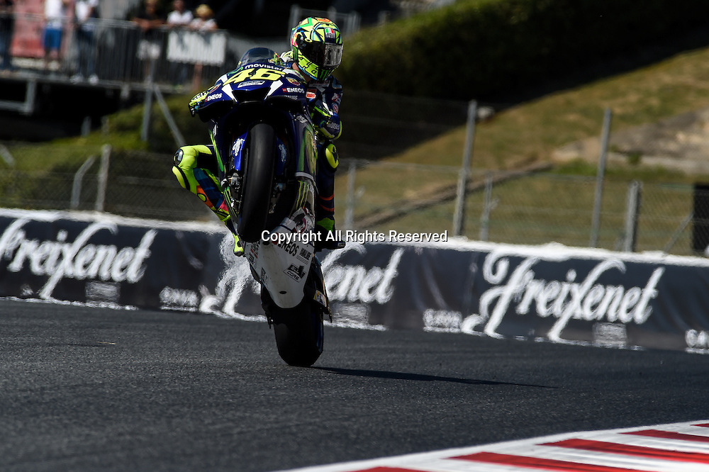 03.06.2016. Circuit de Barcelona, Barcelona,Spain. Grand Prix Monster Energy de Catalunya. Practice day. Valentino Rossi (Movistar Yamaha) does a wheelie during the free practice sessions.