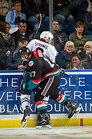 KELOWNA, CANADA - SEPTEMBER 22: Ryan Bowen #17 of the Kelowna Rockets checks Sean Strange #6 of the Kamloops Blazers into the boards  on September 22, 2018 at Prospera Place in Kelowna, British Columbia, Canada.  (Photo by Marissa Baecker/Shoot the Breeze)  *** Local Caption ***