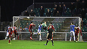 A corner from Nicky Deverdics sails over keeper Craig Ross into the net to give Dover the lead during the FA Trophy match between Whitehawk FC and Dover Athletic at the Enclosed Ground, Whitehawk, United Kingdom on 12 December 2015. Photo by Bennett Dean.