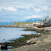 An abandoned boat sits up on the beach in a section of Ushuaia Harbor, Argentina.