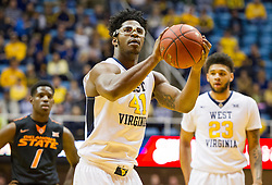 Jan 9, 2016; Morgantown, WV, USA; West Virginia Mountaineers forward Devin Williams (41) shoots a free throw during the first half against the Oklahoma State Cowboys at the WVU Coliseum. Mandatory Credit: Ben Queen-USA TODAY Sports