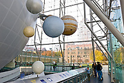 The Rose Center for Earth and Space at the Museum of Natural History in New York City displays the planets hanging above head.