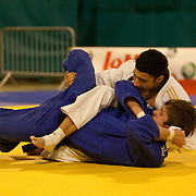 Visé - January 30 : Ashley MC KENZIE from GBR (white) compete with  Mikos SALMINEN from NLD (blue) in the final round match for the 3rd place of Men's -60 Kg during the Judo Open International 2010 in Visé, Belgium. MC KENZIE won  the match.