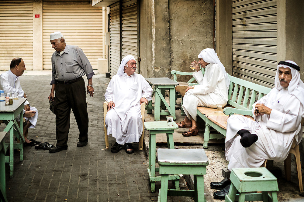Group of local men sharing the tea in the Bahrain Old Souq.
