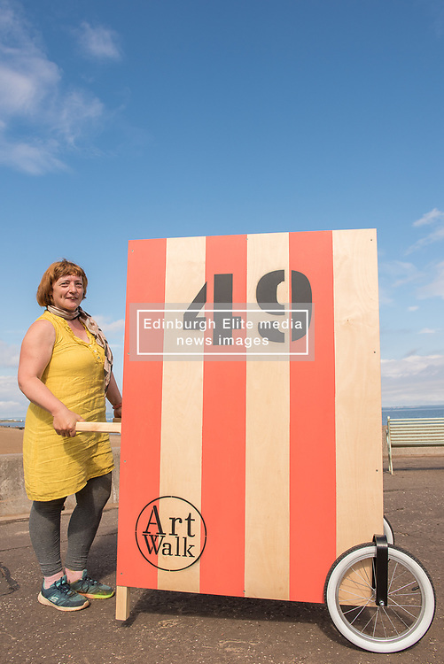 Community arts event Art Walk Porty got underway this afternoon with a promenade procession of the event's 'Art Carts'. The carts, designed to echo the old style bathing carts that used to grace Portobello beach, will be used in a variety of ways by different artists at locations across Portobello, Edinburgh's seaside suburb. The Art Walk is now in its third year and will run over the next day days with a range of events and exhibitions. Pictured: Artist and event director Rosy Naylor.<br /> <br /> <br /> <br /> © Jon Davey/ EEm