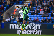 AFC Wimbledon defender Darius Charles (32) climbs for the header during the EFL Sky Bet League 1 match between Bolton Wanderers and AFC Wimbledon at the Macron Stadium, Bolton, England on 4 March 2017. Photo by Simon Davies.