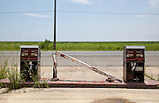 Abandoned and decaying gasoline station along south Louisiana's Highway 23 near Port Sulphur