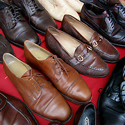 Flea Market rows of men's shoes on table for sale