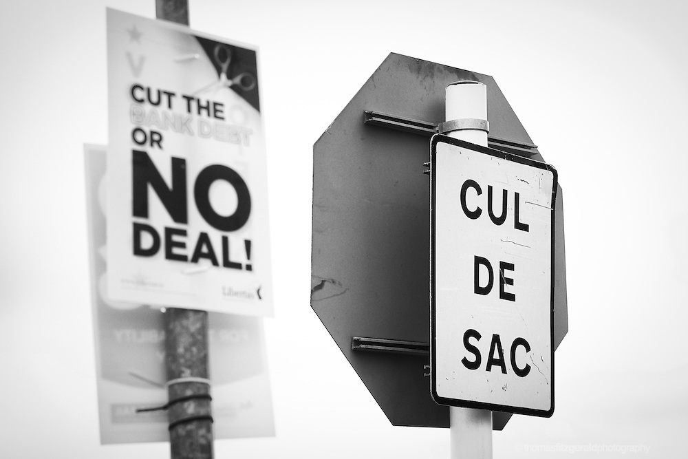 """An ironically placed election poster urging the no vote behind a sign for a dead end """"cul de sac"""""""