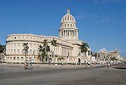 Havana, Cuba - October 21, 2006: Unidentified people walk in front of the Capitolio building on October 21, 2006 in Havana, Cuba.