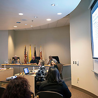 The McKinley County Board of Commissioners are presented with a power point of the McKinley County audit presentation by Farley Vener, Tuesday, March 19, in the McKinley County Commission Chambers in Gallup.