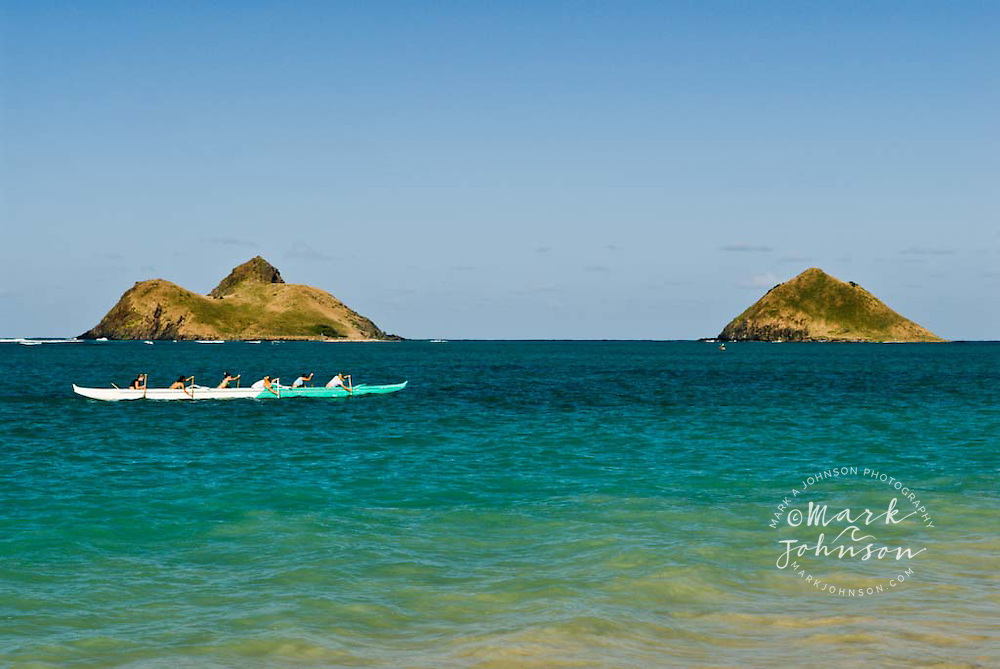 Outrigger canoeists off Lanikai Beach, Mokulua Islands in background, Oahu, Hawaii