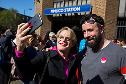 © Licensed to London News Pictures. 03/05/2018. London, UK. Stand up comedian and Labour NEC member EDDIE IZZARD poses for a selfie with a fan outside Pimlico Tube Station as part of 'Unseat Westminster Tory Council'. The gathering was arranged to round up volunteers to speak to Westminster residents who said they would vote for labour. Photo credit : Tom Nicholson/LNP