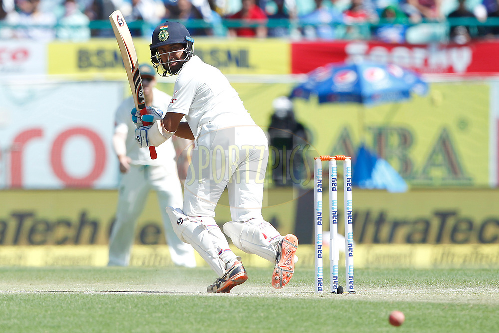 Cheteshwar Pujara of India bats during day two of the fourth test match between India and Australia held at the Himachal Pradesh Cricket Association Stadium on the 26th March 2017.<br /> <br /> Photo by: Deepak Malik/ BCCI/ SPORTZPICS