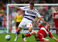 Loftus Road, London - Saturday 11th September 2010: Nicky Bailey (10) of Middlesborough (R) tackles Bradley Orr (2) of QPR during the Npower Championship match between Queens Park Rangers and Middlesborough. (Photo by Andrew Tobin/Focus Images)