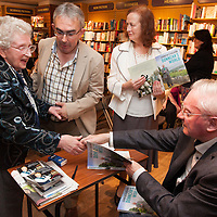 Mary Hanrahan, mother of RTE presenter Kieran Hanrahan, greeting Donncha O Dúlaing at Ennis Bookshop