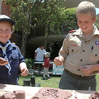 "Garrett Kirk, 10, a Scout from Santa Monica Pack 67, and his younger brother Sean, 8, a ""Bear Scout,"" make clay sculptures during the 4th Annual Cub Scout Fun Day at the Methodist Church on Saturday, June 9, 2007."