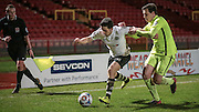 George Honeyman (Gateshead) takes on the Southport defender and goes around the outside of him during the Vanarama National League match between Gateshead and Southport at Gateshead International Stadium, Gateshead, United Kingdom on 8 December 2015. Photo by Mark P Doherty.