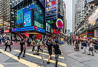Causeway Bay, Hong Kong, China- June 6, 2014: people shopping in the streets of Causeway Bay