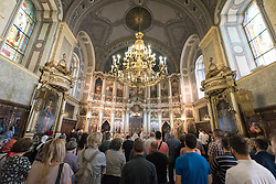 "3 June 2018, Novi Sad, Serbia: On Sunday, participants of the CEC general assembly attended Sunday service in local churches in and around Novi Sad. Here, in the Eastern Orthodox Cathedral Church of the Holy Great Martyr George. The Conference of European Churches General Assembly takes place on 31 May - 6 June 2018, in Novi Sad, Serbia. More than 400 delegates, advisors, stewards, youth, staff, and distinguished guests take part in the 2018 General Assembly and related events. Gathered together under the theme, ""You shall be my witnesses,"" the assembly forges the path for CEC for the coming five-year period and beyond. Of central concern is the future of Europe in light of economic, political, and social crises and how the churches will live out a vision of witness, justice, and hospitality within this context."